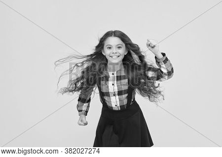 Run Baby Run. Energetic Child Run To School Yellow Background. Back To School. Childhood Activity. E