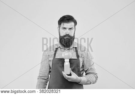 Delivering Fresh Vitamins. Hipster Smoothie Beverage. Man Bearded Chef Hold Organic Natural Tomato A
