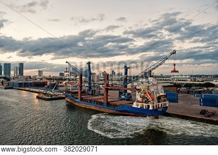 Miami, Usa - March 01, 2016: Empty Cargo Ship In Port. Ship Container On Cloudy Sky. City Skyline Ba