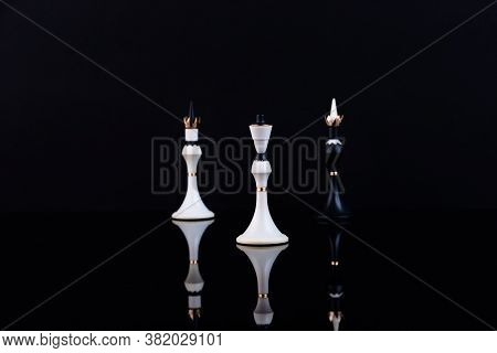 The Concept Of Choice, Merger And Acquisition. Chess Pieces On A Black Background. Selective Focus.