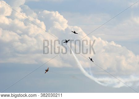 Airshow Planes Group With Smoke Against The Blue Sky