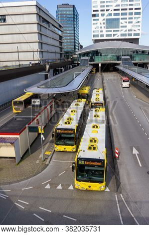 Utrecht, The Netherlands - 16 Mar, 2020: Yellow Articulated Busses Departing From The Bus Station At