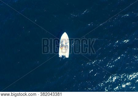 Aerial View Fisherman On Boat At The Ocean. Top View Beautiful Seascape With The Fishing Boat. Aeria