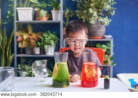 Happy Little Asian School Kid Studying Science, Making Diy Lava Lamp Science Experiment With Oil, Wa