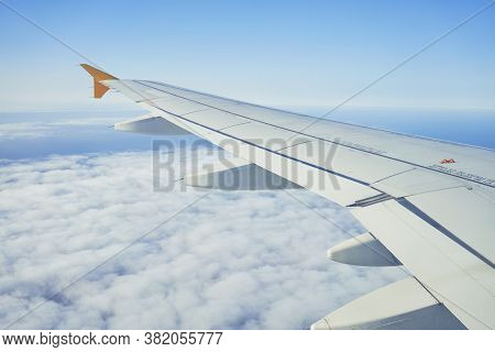 Cloudscape from window airplane, landscape of wing plane on a cloudy sky
