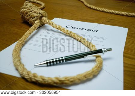 Contract With Pen And Rope Tied In Hangmans Noose. Strangulation Contract, Unfair Agreement.