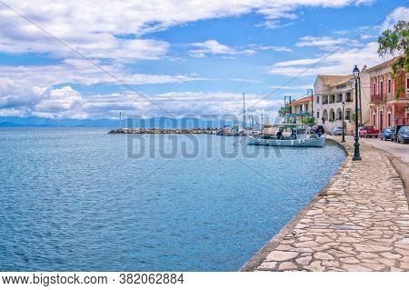 Paxos Island/greece- May 7, 2019: View Of Beautiful Loggos Harbor - Sea Bay, Old Fisher Boat, Colorf