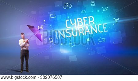 Businessman defending with umbrella from cyber attack and CYBER INSURANCE inscription, online security concept