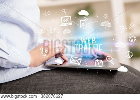 Close-up Of A Person Using Social Networking with WEB TRAFFIC inscription