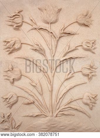 Agra, Uttar Pradesh State, India - January 2, 2020: Marble Flowers Bas-relief - Exterior Detail Of T