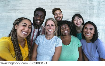 Group Multiracial Friends Having Fun Outdoor - Happy Mixed Race People Taking Selfie Together - Yout