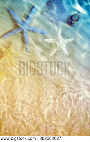 Starfish On The Summer Beach With Sand And Wave. Summer Background. Summer Time.