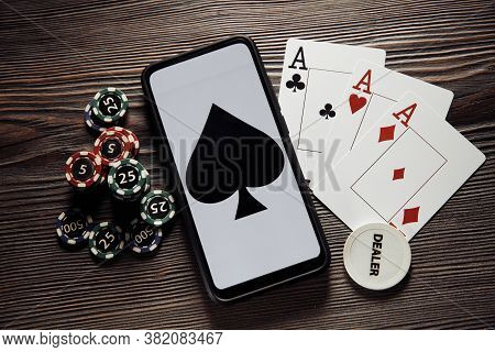 Poker Play Online. Poker Chips And Smartphone