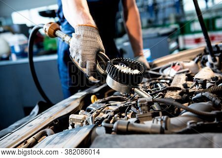 Car Mechanic Change Engine Oil. Car Repair. Service Station