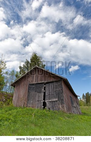 Old Barn On A Field