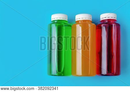 Non-alcoholic Multi-colored Carbonated Drinks In Plastic Bottles On Blue Background, The Concept Of