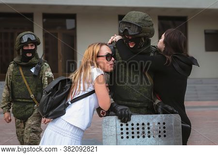 Minsk/ Belarus - August 13, 2020: Girl Hugs A Soldier During A Peaceful Protest In Belarus
