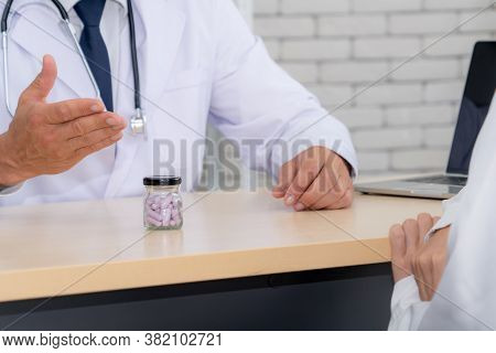 Doctor In Professional Uniform Examining Patient At Hospital Or Medical Clinic. Health Care , Medica