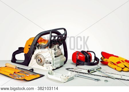 Repairing A Chainsaw In Workbench . Place For Text. Concept Repair Gasoline Powered Tools.