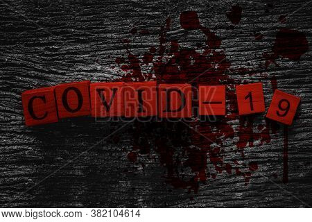 Covid-19 Name Of Corona Virus Text On Old Wood Block With Blood And Gore Effect For Scary Look For W