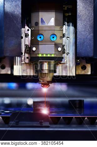 Industrial Laser Cut Machine While Cutting The Sheet Metal With The Sparking Light