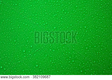 Water Droplets On The Green Background For Cool And Fresh Texture.