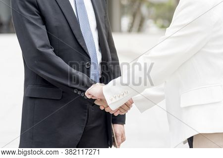 Congratulation To Collaboration Partner After Sign On Contract. Diverse Businessman Shake Hands Toge