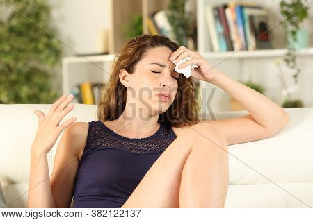 Woman Complaining Suffering Heat Stroke Drying Sweat Sitting On A Sofa In The Living Room At Home