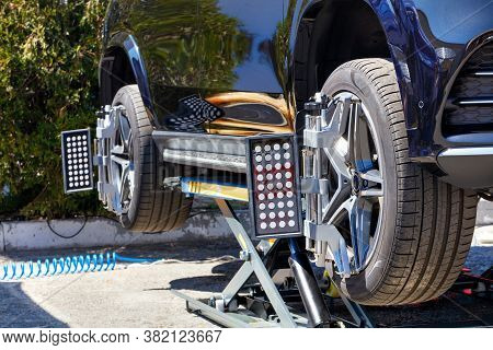 Equipment For Aligning The Wheels Of A Car On A Mobile Stand In A Repair Station. The Car Stands On