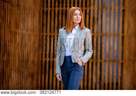 Confident Business Expert. Happy Successful Professional Posing Near Office Building. European Girl.