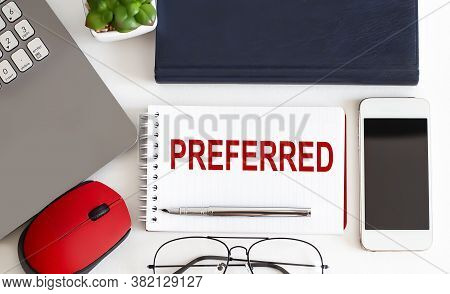 Preferred Text With Fountain Pen, Decorative Plant, Keyboard And Notepad On Wooden Background. Busin