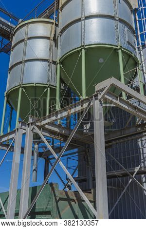Grain Huge Metal Silos.. Agricultural Industrial Background.