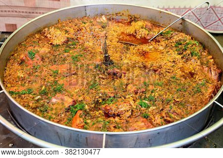 Freshly Cooked Large Portion Of Cabbage And Meat Meal Decorated With Fresh Green Dill, Cooked And Di
