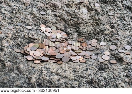 On The Stone Surface Is A Pile Of Metal Kopecks And Coins