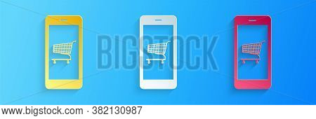 Paper Cut Online Shopping Concept. Shopping Cart On Screen Smartphone Icon Isolated On Blue Backgrou
