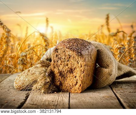 Bread Assortment On Background Of A Wheat Field