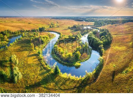Aerial View Of Beautiful Curving River At Sunrise In Summer. View From Air. Turns Of River, Green Me