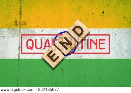 End Of Quarantine. The Inscription On Wooden Blocks On The Background Of The Flag Of India. The End
