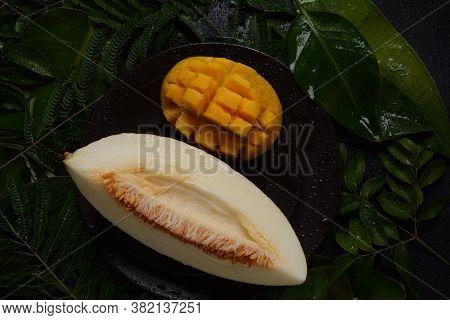 Melon Slice On Herb Background. Sliced Juicy Piece Of Melon.