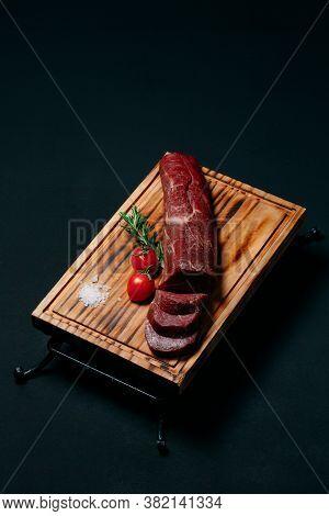 Raw Tenderloin Meat On A Black Background.