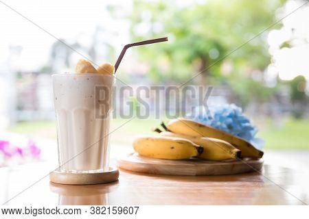Banana Smoothies Glass On Wood Table. Banana Milk Shake With Fresh Fruit. Fresh Made Banana Smoothie