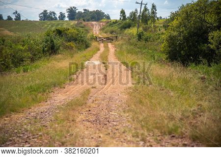 A Dirt Road In The Interior Of Brazil. A Gate In The Middle Of The Road. A Path To Infinity. Feeling