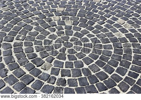 Black Stone Pavement. Stone Blocks In The Form Of Circles. Granite Cobblestone Pavement. Texture For