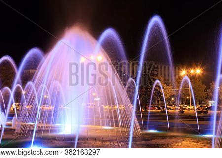 The Scenic View Of Picturesque Musical Fountain With Colorful Illumination At Night, Ukraine Dneprop