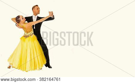 Ballroom Couple Dance In Yellow Dress Dance Pose Isolated On Black Background. Sensual Professional