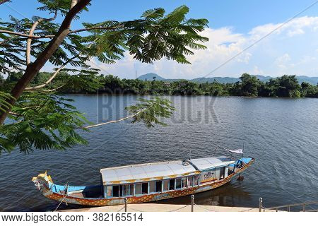 Hue, Vietnam, July 15, 2020: Boat On Perfum River With Mountains In The Background In Hue, Vietnam