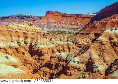Picturesque spurs of red sandstone mountains. USA. Arizona, Utah. Paria Canyon-Vermilion Cliffs Wilderness Area. The concept of active, extreme and photo tourism