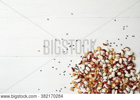 Mixed Vegetable Seeds On White Wooden Background, Flat Lay