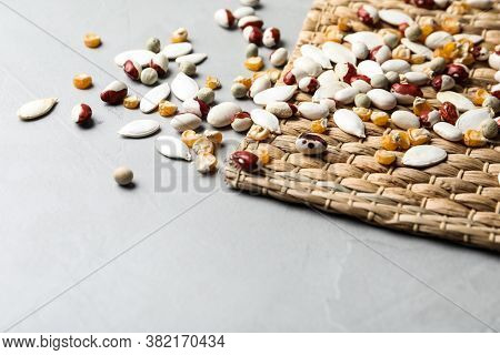 Mixed Vegetable Seeds On Grey Background. Space For Text