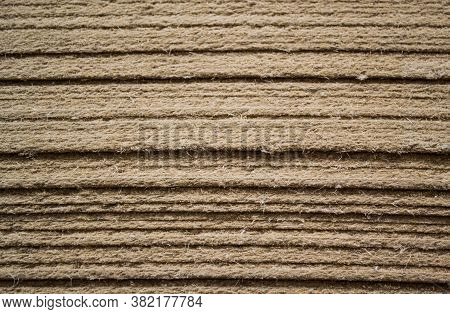 Stacked On Top Of Each Other The Sheets Of Hardboard Medium Density Fiberboard. Close-up Of The End